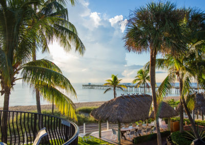 Photo from one of our balconies of an early morning of the beach and pier.