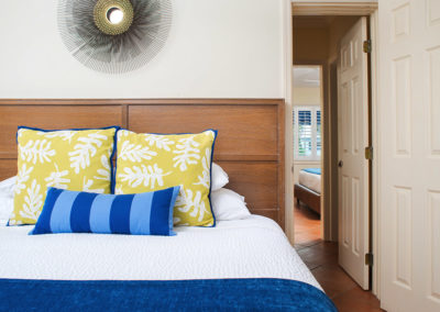 Photo of one of our rooms displaying a bed and headboard.