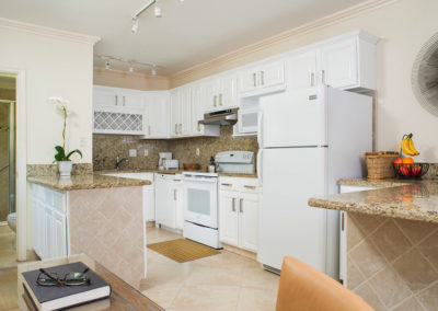 Photo of one of our rooms displaying a full kitchen.