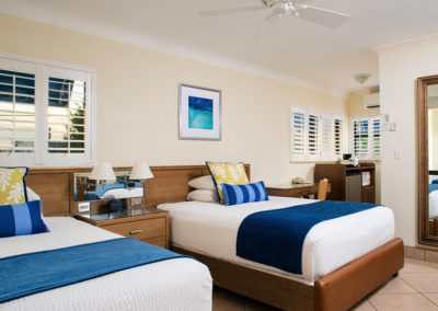 Photo of one of our rooms displaying two twin size beds.